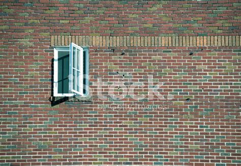 open brick wall open window in brick wall of building stock photos