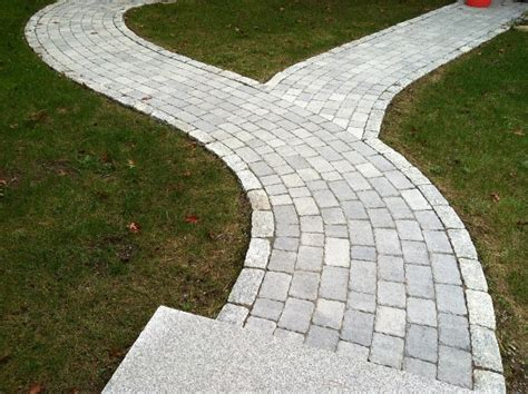 curved sidewalk walkway and patio design in ma natural path landscaping