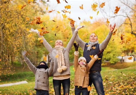 happy family playing  autumn leaves  park stock