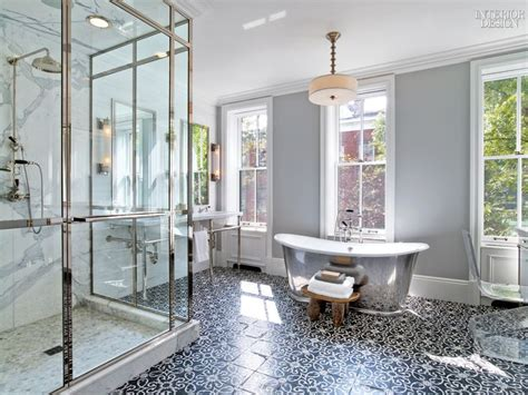 gray bathroom with black and white mosaic tile floor