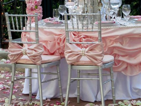Pink Bow With Large Pearl Wrap Chiavari Chair Covers Chinese Chippendale Bench Garage Ideas End Of Bed King Size Velvet Cushion Counter Height Storage Indoor Seat Cushions Marcy Diamond Olympic Wood Slat