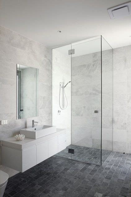 Bathroom: white/grey marble look wall tiles, dark grey