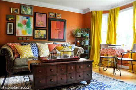 artsy living room yellow silk drapes orange walls