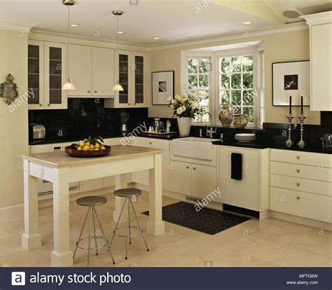 modern country kitchen cream units black granite worktops