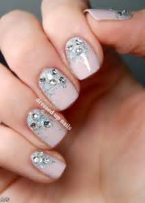 Trends as acrylic nails with bows and rhinestones