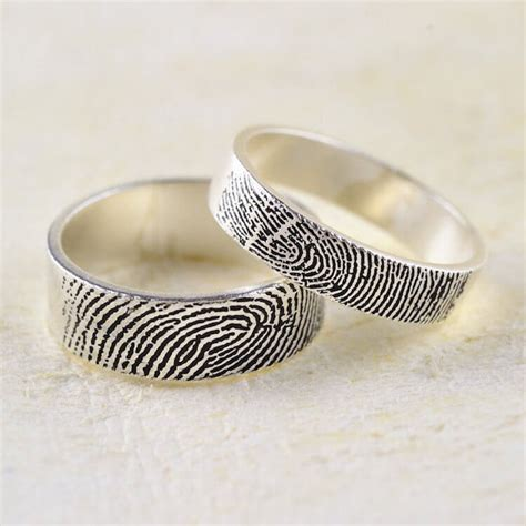 the fingerprint wedding ring lets you carry his fingerprints with you wherever you go
