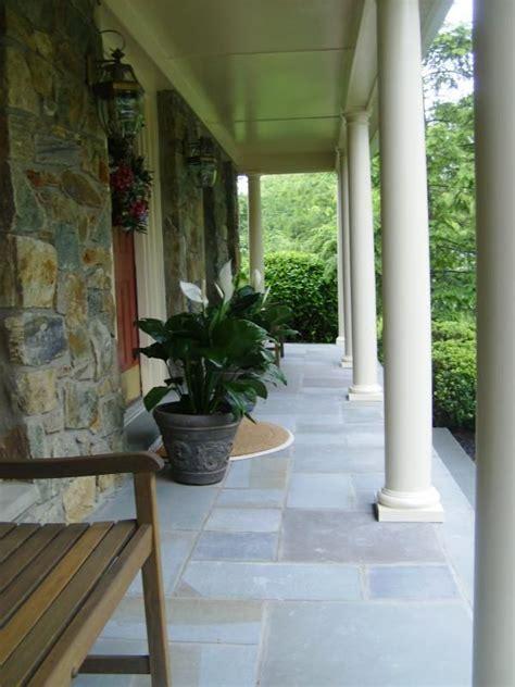 Cut bluestone porch veneered over top old, concrete porch