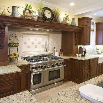 Decorating Ideas For Above Cabinets In Kitchen by Mediterranean Style Kitchens Millard Townhouse Ideas