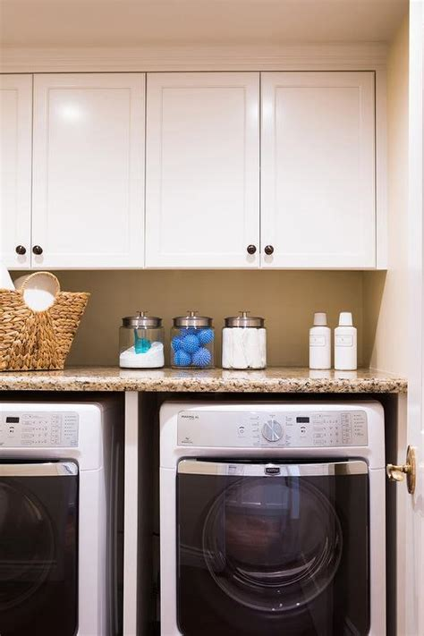 cabinets over washer and dryer enclosed washer dryer design ideas
