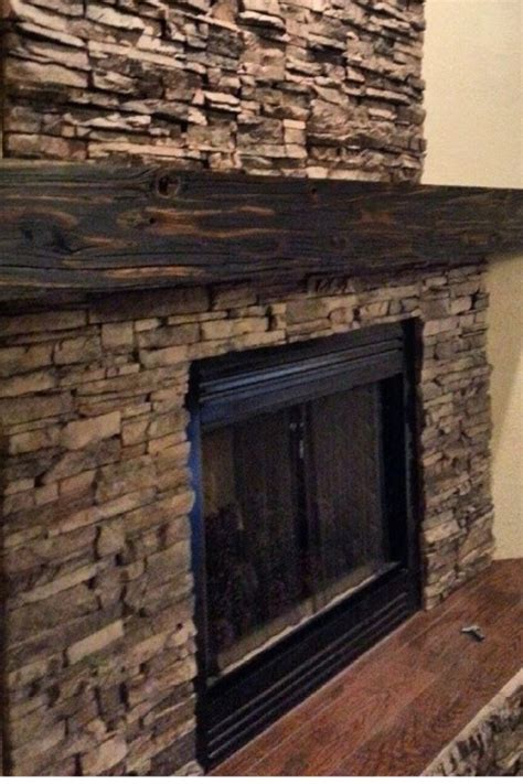 reclaimed wood ledge stone fireplace fireplace