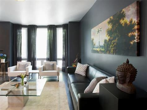modern gray living room  bay windows  colorful art hgtv
