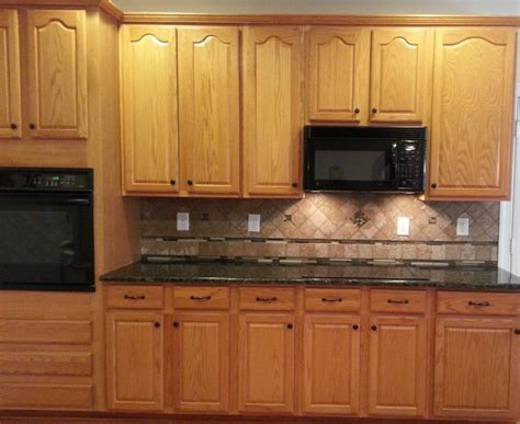 how to take kitchen cabinets honey oak cabinets with verde butterfly countertops 8915