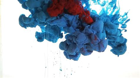 blue color paint flow injected in water mixing with