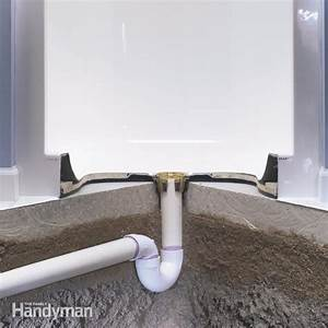 How to install a fiberglass base over concrete the for Installing a shower tray on concrete floor