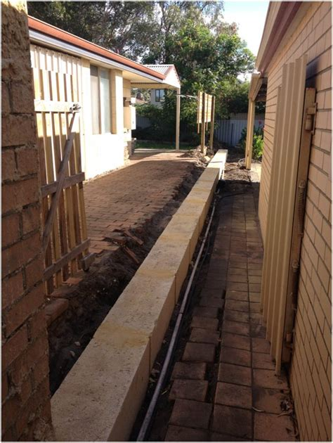 installing  fence  top   limestone wall perth
