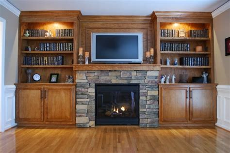 gas fireplace with built in cabinets custom built in cabinets and stone surround fireplace
