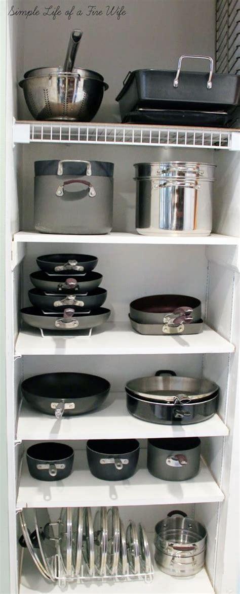 kitchen pots pans storage organize organization lids under organizing organized cupboards countertop organisation read countertops idea cupboard