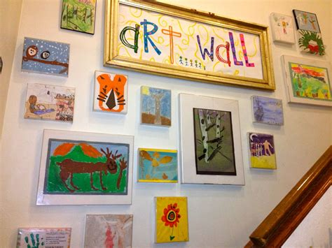 Kids Art Wall Using Cheap Plastic Frames That We Used To