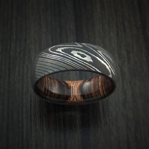 damascus steel ring with hardwood interior sleeve custom