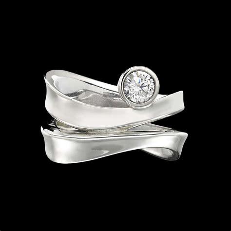 Contour Diamond Ring. Woodworking Rings. January Birthstone Wedding Rings. Love Life Wedding Rings. Sapphire Underneath Wedding Rings. Daisy Flower Engagement Rings. Delicate Flower Wedding Rings. Stolen Engagement Rings. Twisted Wire Rings