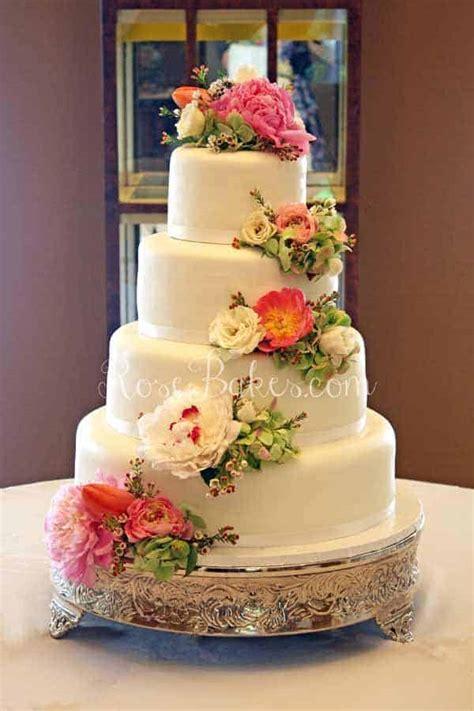 white wedding cake  cascading fresh flowers rose bakes