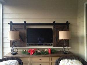 sliding barn doors sliding barn doors to cover tv With barn doors to hide tv