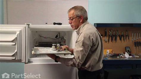 refrigerator repair replacing  evaporator fan motor