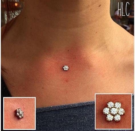 dermal implant piercings  mantra tattoo  tattoo