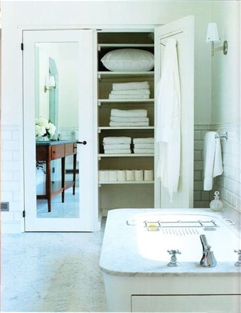 bath with mirrored linen closet doors closet bath
