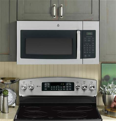 ge microwave with vent fan ge jvm3160 over the range microwave oven with 1 6 cu ft