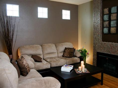 brown living room  suede sofas  tile fireplace hgtv