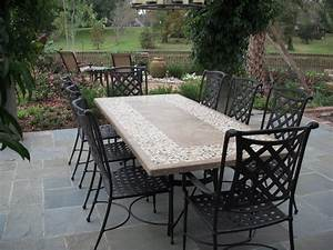 Stone top dining table with outdoor chairs from Bay Breeze