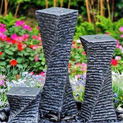solar powered three granite twists garden water feature