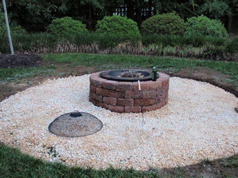 gas fireplace river rocks punkwife com outdoor diy project firepit patio