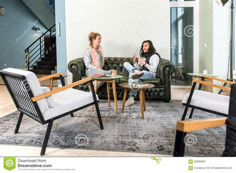 Two People Talking In A Lounge Stock Photo  Image 63890087