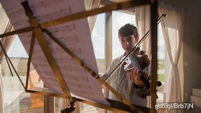 Violin Playing Footage Behind August Sold Notes