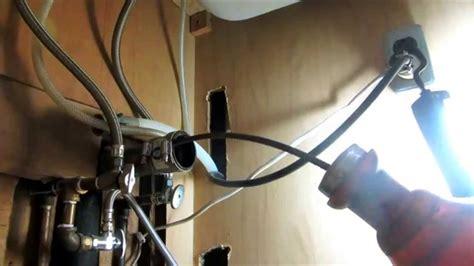 snaking a kitchen sink drain snake a draining kitchen sink drain 8149