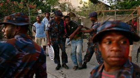 foreign troops pour  papua  guinea  apec summit