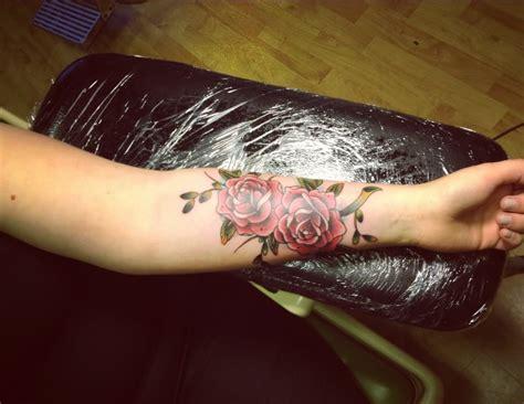 beautiful forearm rose tattoos
