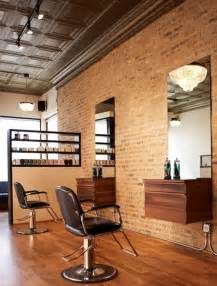 brick wall decor with black leather swivel chairs for