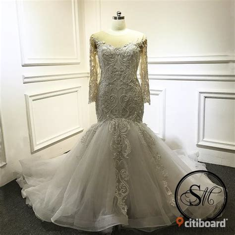 Bröllopsklänning spets långärmad