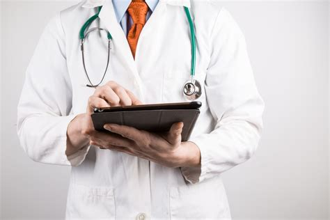 Doctor Tablett by Doctor With Tablet Free Stock Photo Domain Pictures