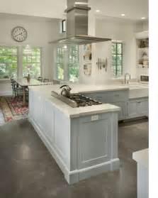 White Kitchen with Concrete Floor