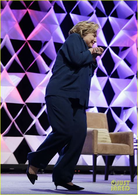 woman throws shoe  hillary clinton   photo