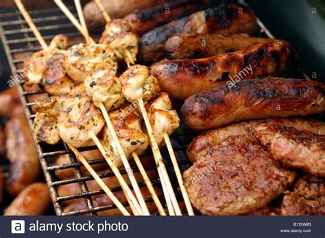 grille cuisine food on bbq grill cooking chicken and sausages stock photo