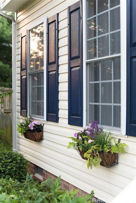 window flower basket  vinyl siding   place