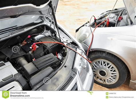 Starting Car Engine With Battery Jumper Cables Royalty