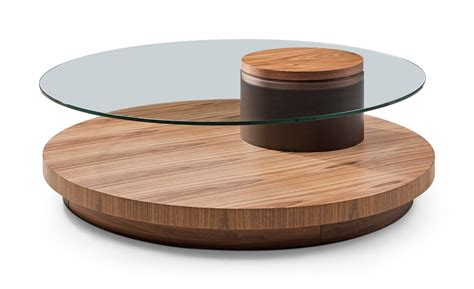 Usually people think that a round glass coffee table is too small for their home or living room so for them, not properly fit but that is not true. Modrest Memphis Modern Walnut & Glass Round Coffee Table ...