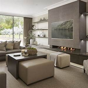 very contemporary and neutral family room off the kitchen With modern family living room design