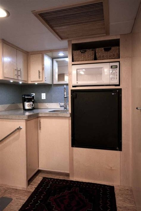man turns cargo trailer  transforming stealth tiny house